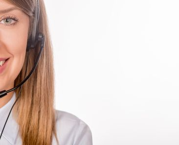 Portrait of happy smiling cheerful support phone operator in headset, isolated on white background Female customer support operator with headset and smiling